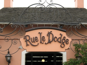 The ornate, Orleans-inspired entrance to the attraction in question.