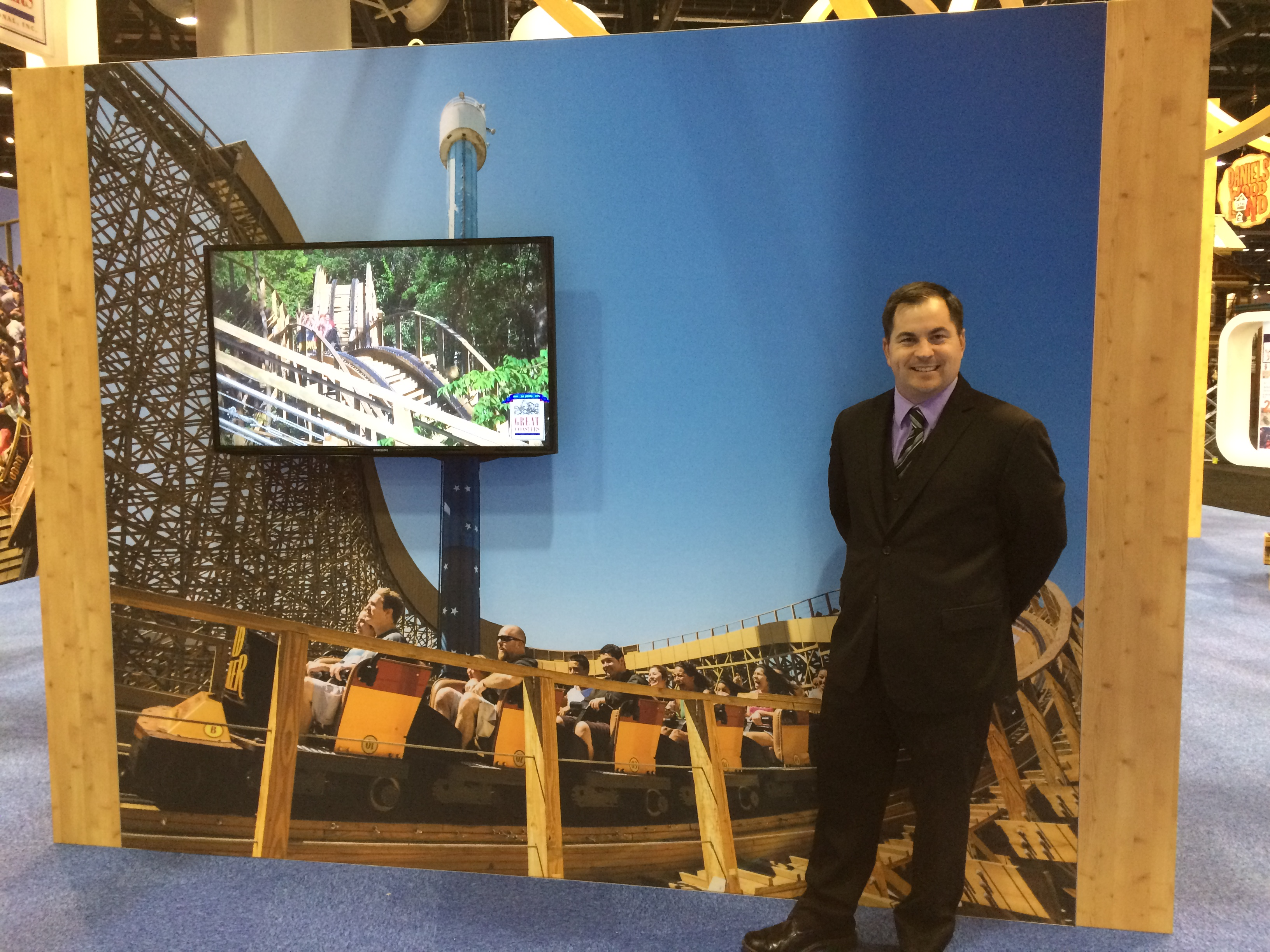 Standing next to one of my photos in the Great Coasters booth.